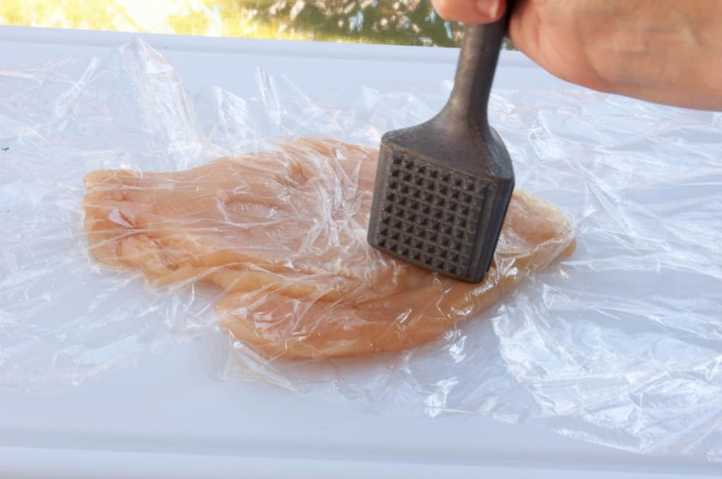 Flatten chicken with meat mallet