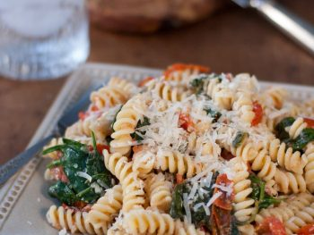 Fusilli Pasta with spinach, Asiago cheese, and cherry tomatoes - The Kitchen Snob