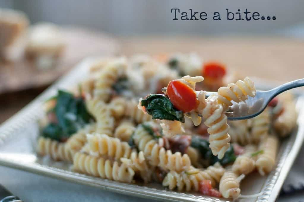 Fusilli pasta with spinach, Asiago cheese, and cherry tomatoes - www.thekitchensnob.com