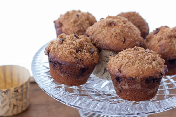 Clear crystal cake plate loaded with lots of cinnamon muffins