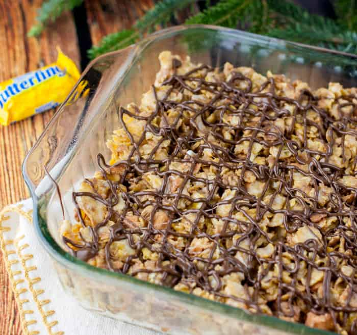 These Crispy Flaky Butterfinger Treats are a step up from traditional Rice Krispies treats. LOVE this recipe!