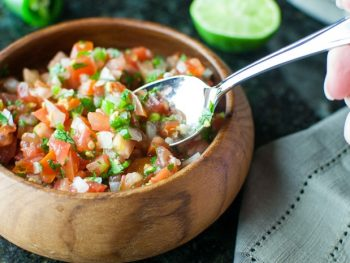 Pico de Gallo (Salsa Fresca) recipe is a perfect topping to many dishes. Make it mild or spicy!