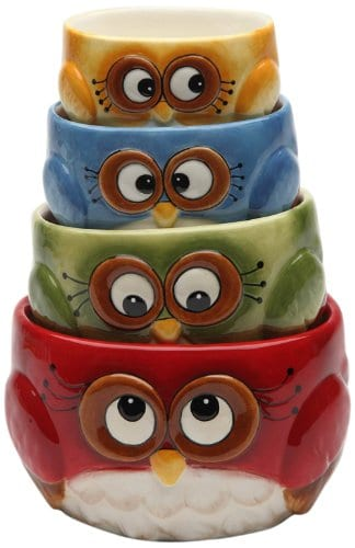 4 ceramic measuring cups stacked up that look like owls