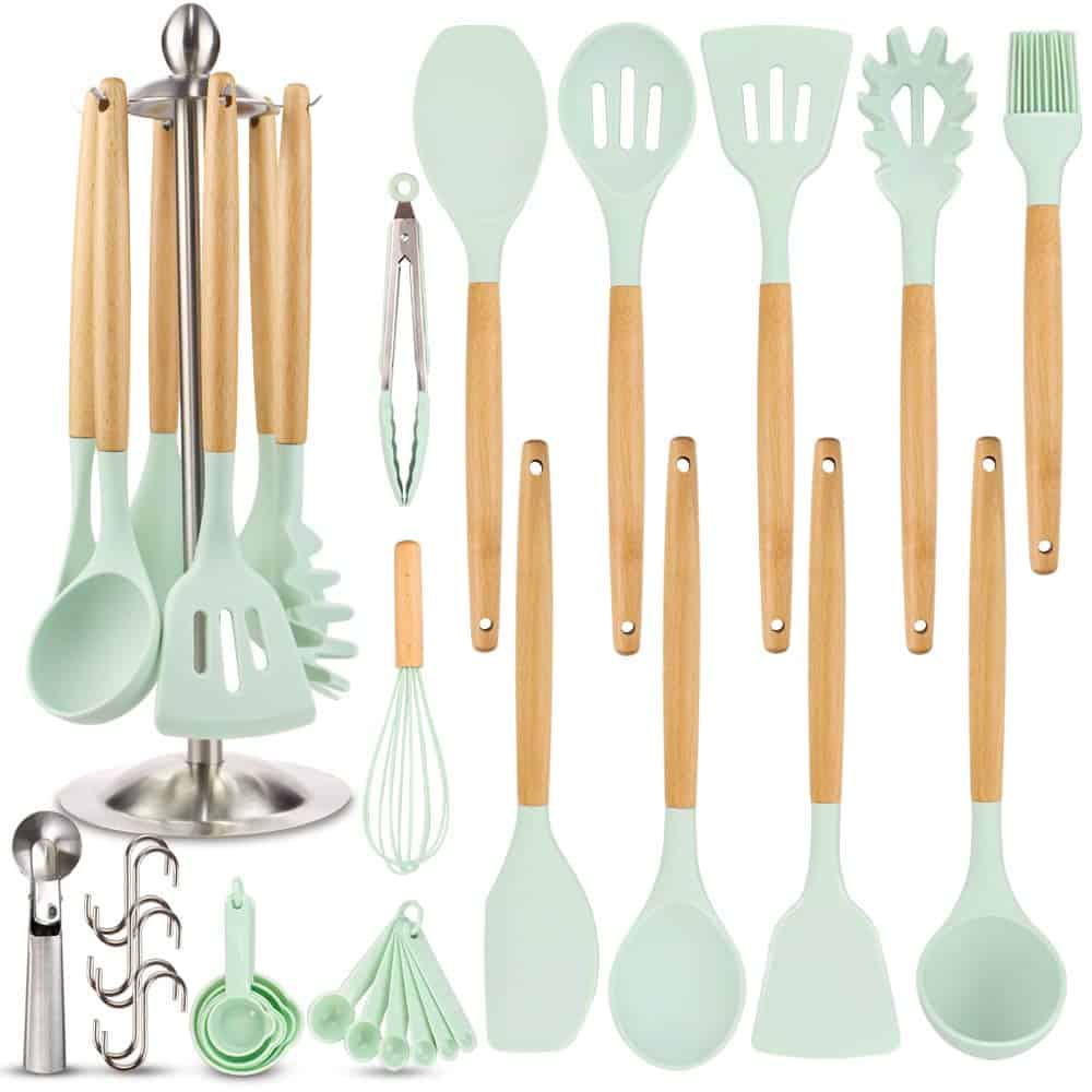 Set of mint green silicone cooking utensils with light wooden handles