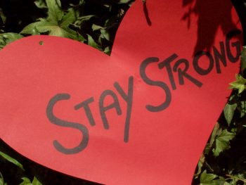 Cut out red paper hard that says Stay Strong