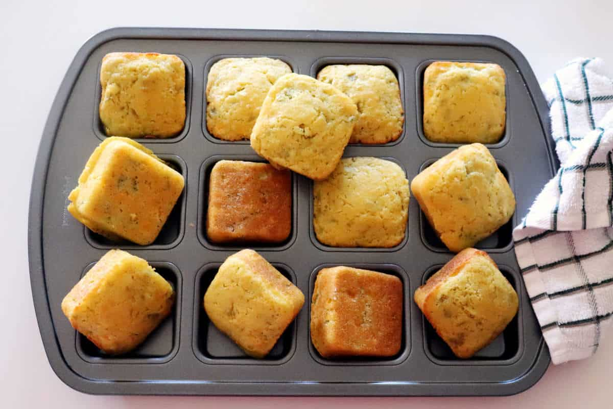 Pan of chili cornbread just out of the oven baked into little squares